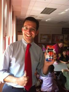 teacher holding school supply gifts