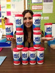 teacher posing with wet ones gifts