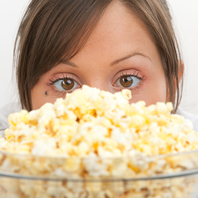 woman with a bowl of popcorn