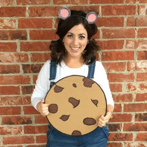 Woman wearing mouse costume holding a cookie
