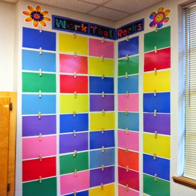 Wall of student work on colored paper