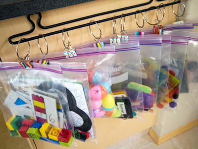 educational game pieces in clear baggies