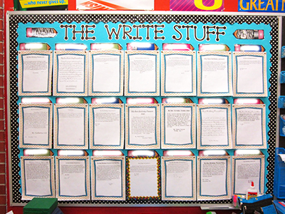 bulletin board with student's writings displayed