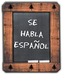 Chalkboard with Se Habla Espanol written in chalk